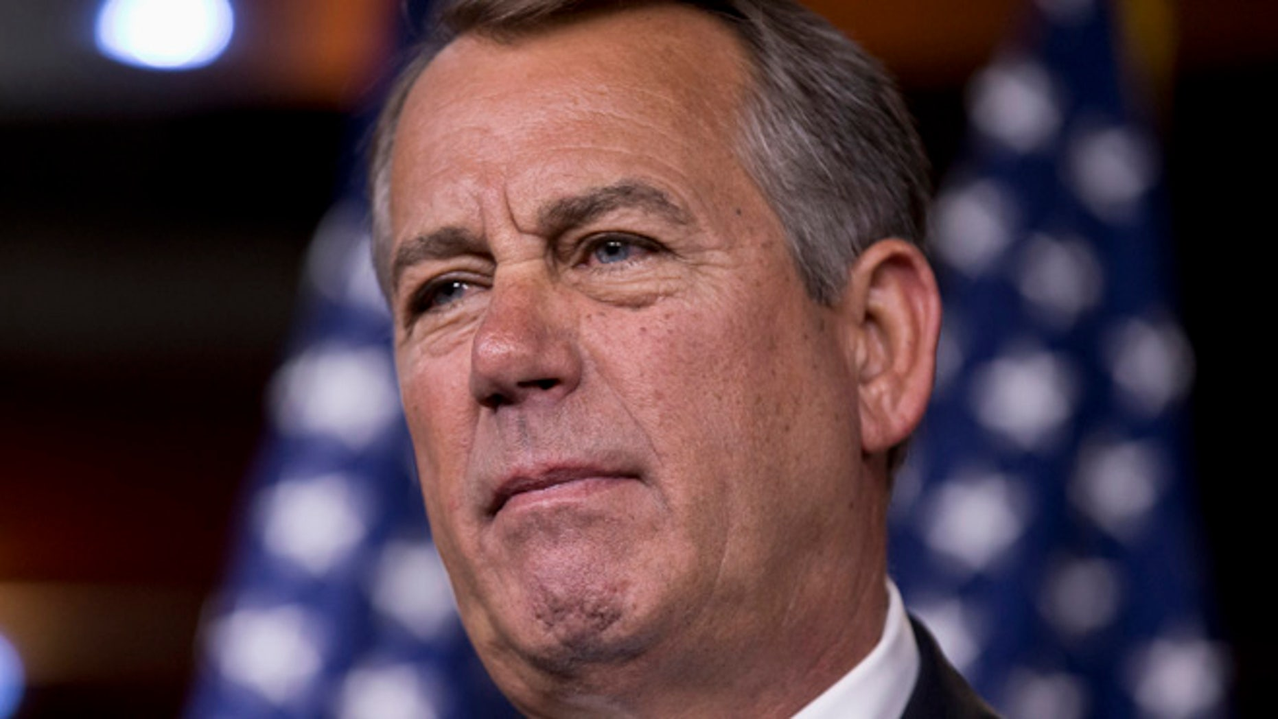 Aug. 1, 2013: House Speaker John Boehner takes questions from reporters at a Capitol Hill news conference.
