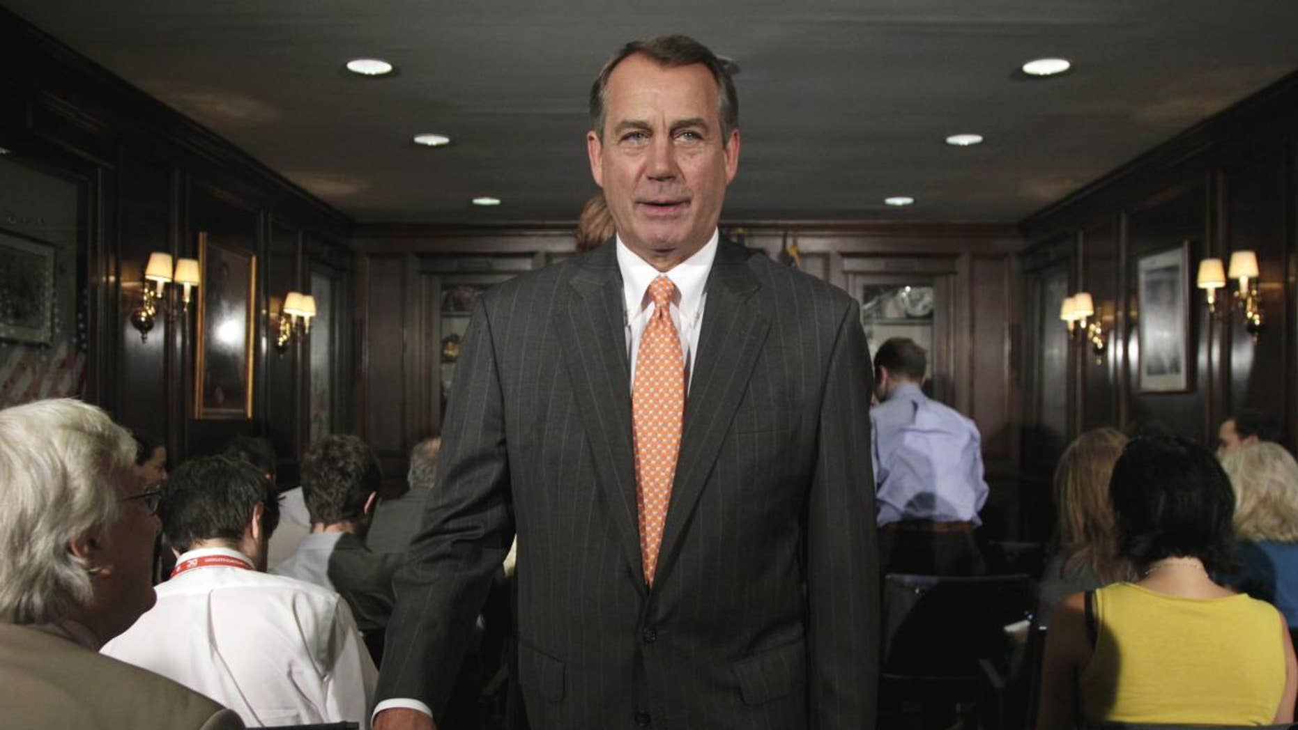 House Speaker John Boehner of Ohio leaves after making a statement at The Republican National Committee on Capitol Hill in Washington, Tuesday, July 26, 2011. (AP Photo/Carolyn Kaster)