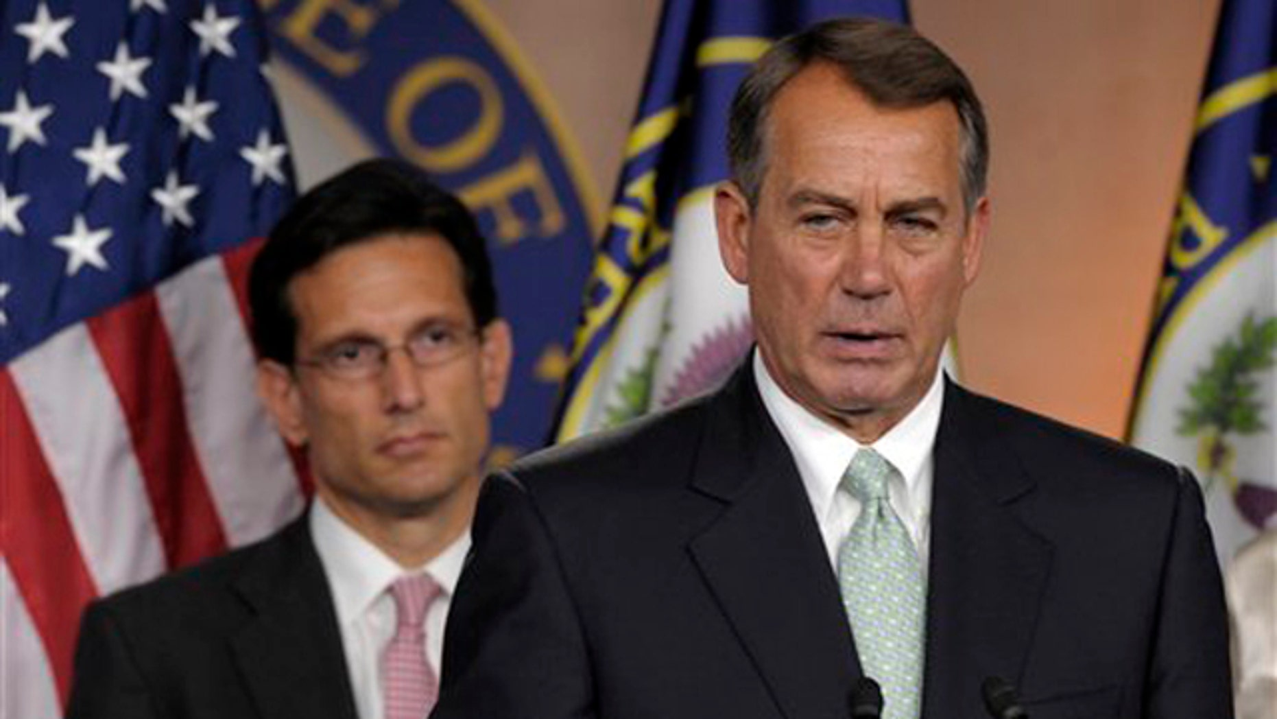 House Speaker John Boehner, right, speaks during a news conference with House Majority Leader Eric Cantor on Capitol Hill in Washington July 15.