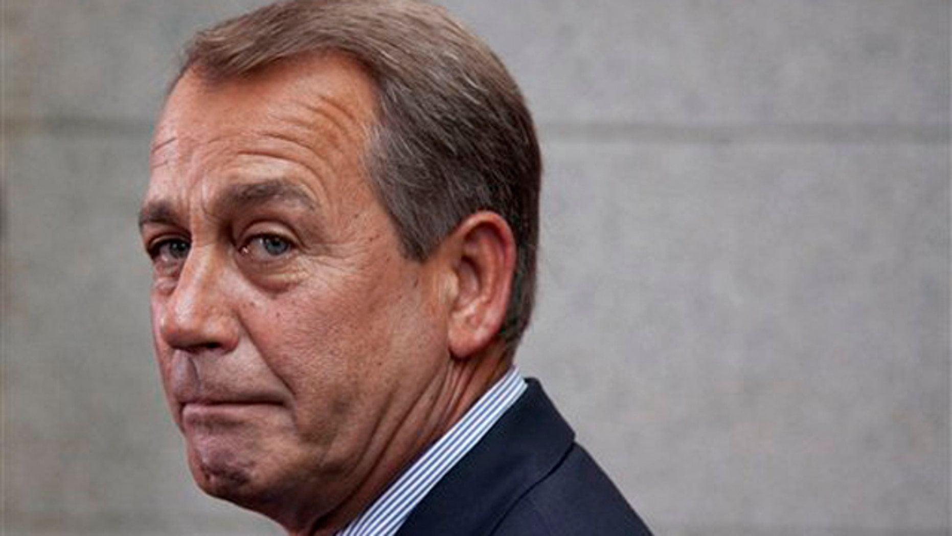 House Speaker John Boehner makes a statement after a Republican caucus meeting on Capitol Hill Sept. 8.