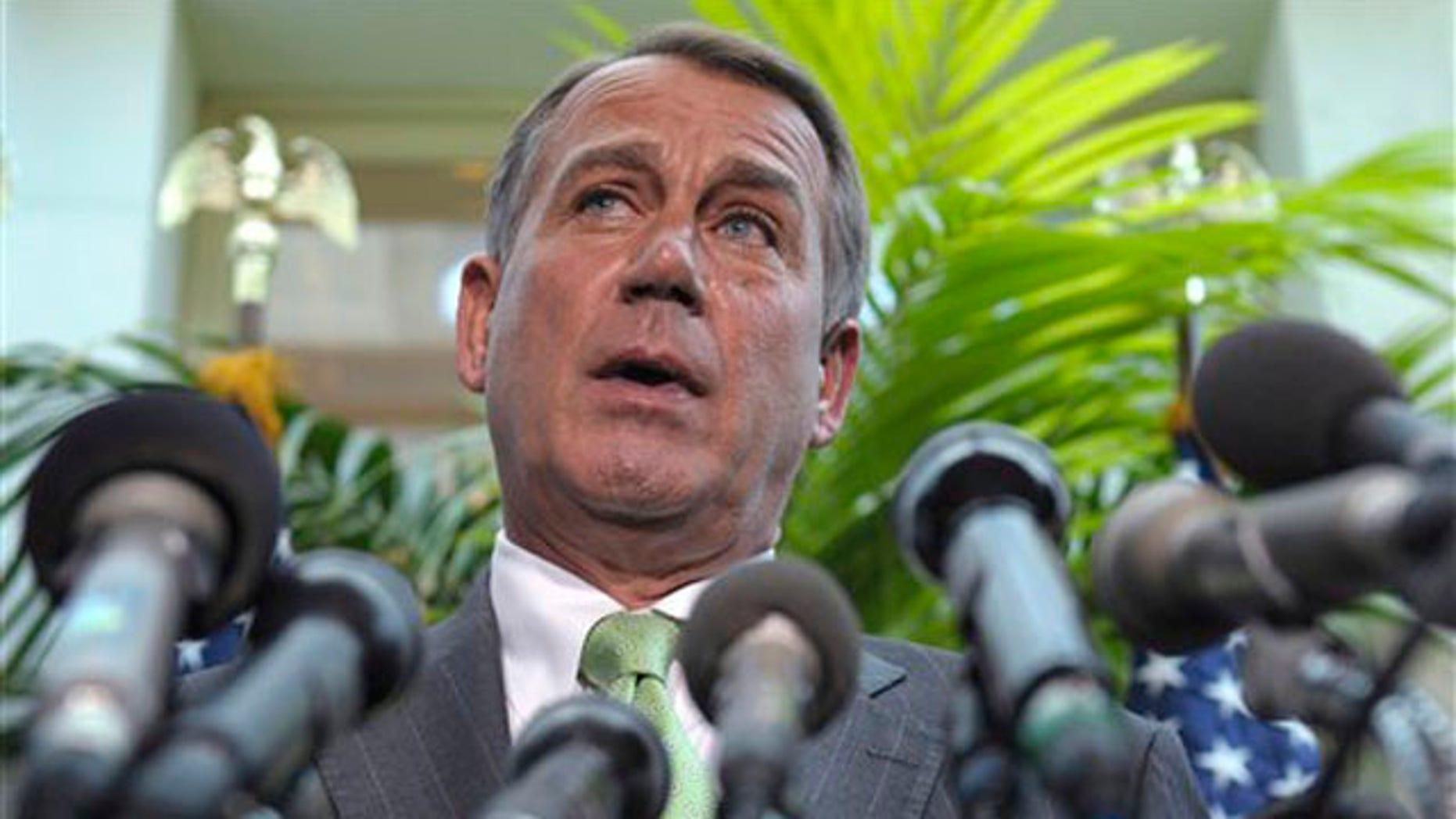 House Speaker John Boehner speaks at a news conference on Capitol Hill in Washington July 12.