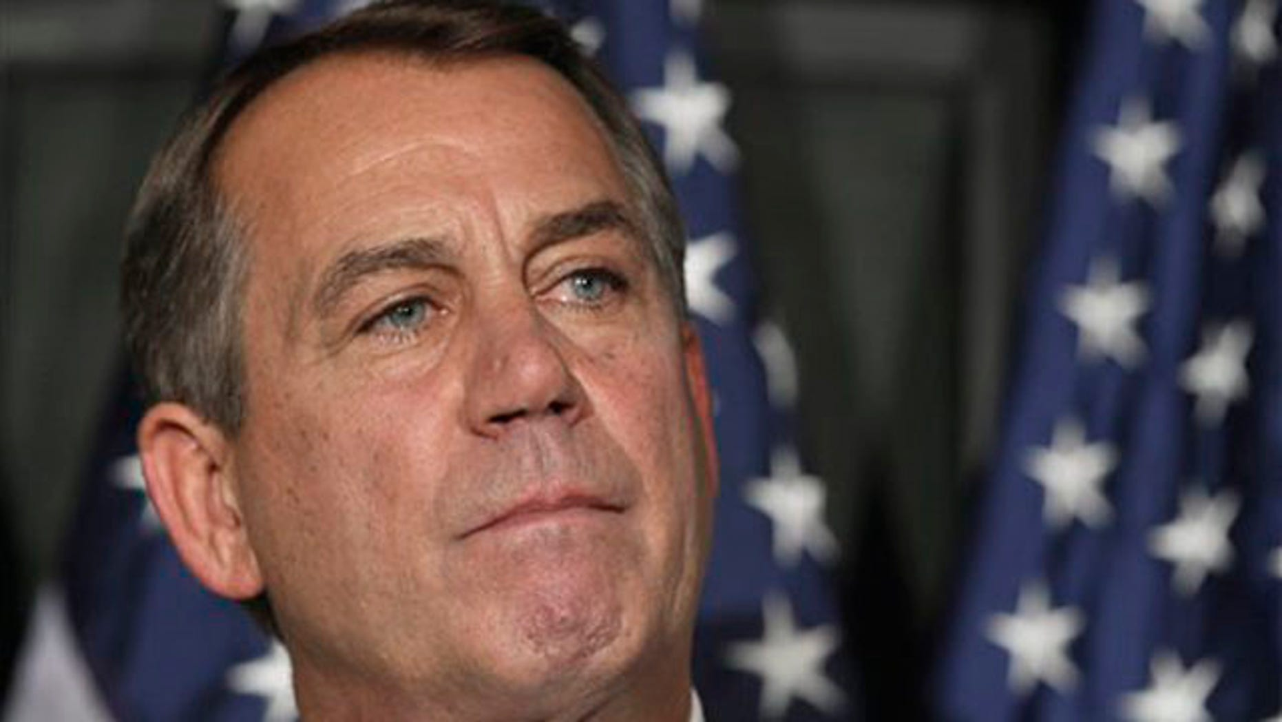 House Speaker John Boehner pauses during a news conference at The Republican National Committee on Capitol Hill in Washington July 26.