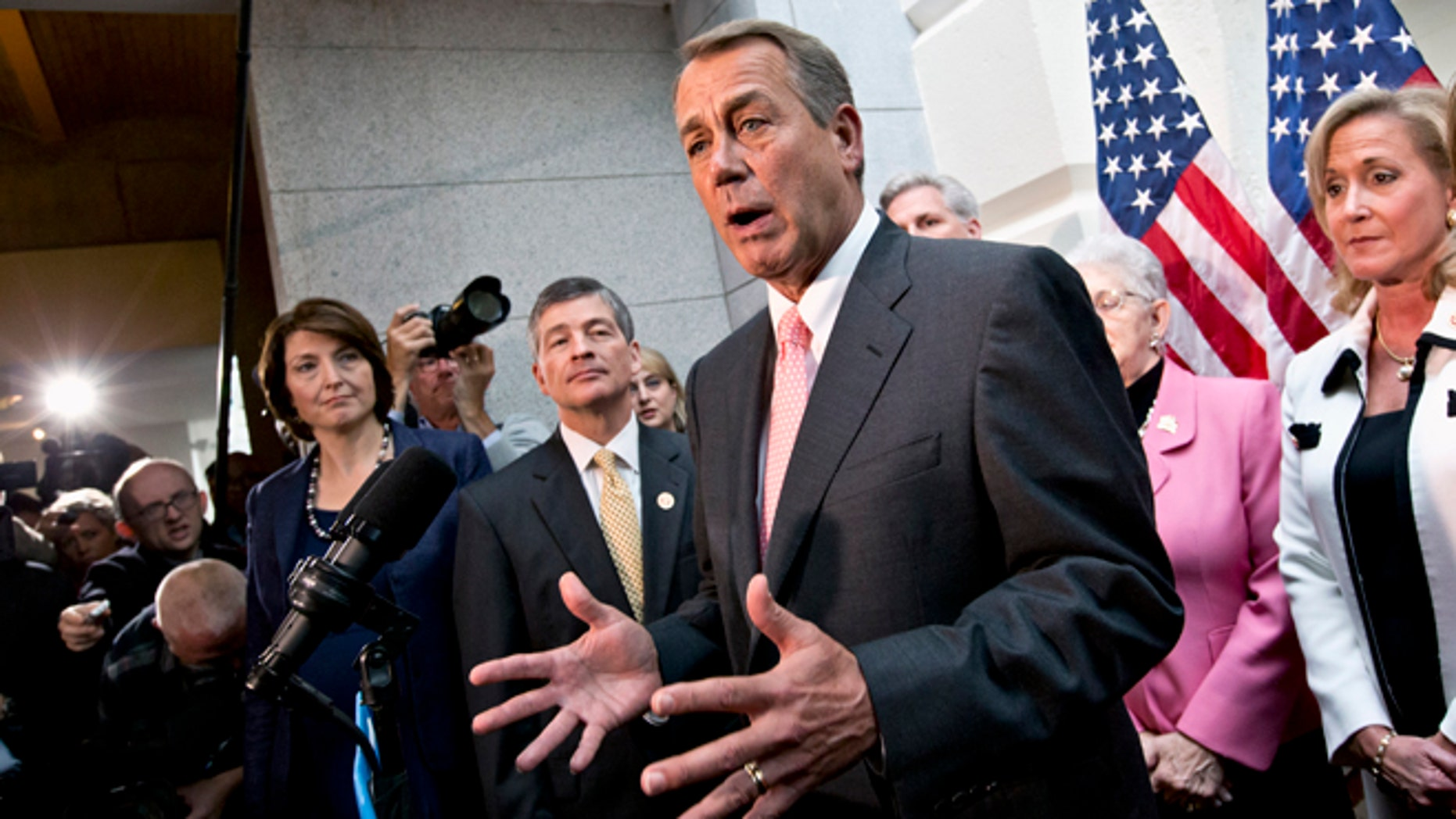 Oct. 10, 2013: House Speaker John Boehner, joined by fellow Republicans, speaks during a news conference on Capitol Hill in Washington.