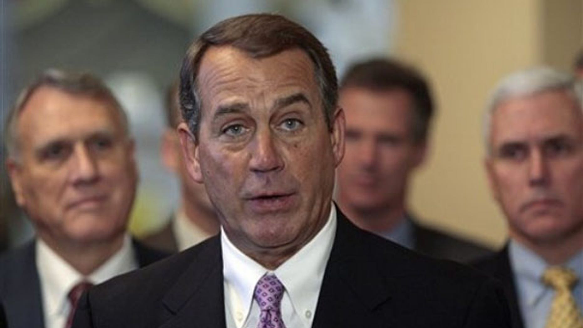 House Minority Leader John Boehner speaks to reporters, alongside other House and Senate lawmakers, on Capitol Hill March 18. (AP Photo)