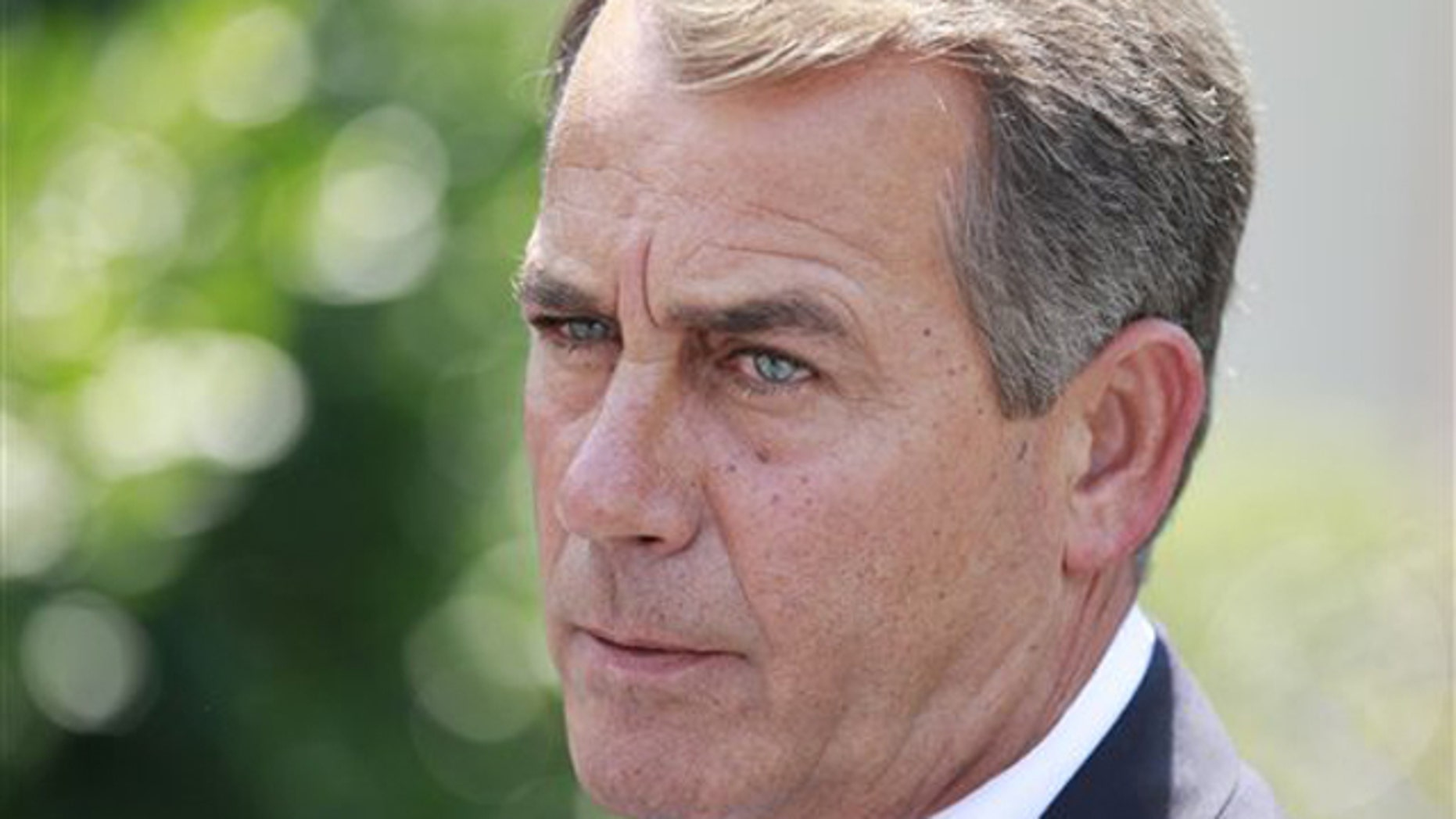 In this June 10 photo, House Minority Leader John Boehner speaks to reporters outside the White House in Washington following a meeting with President Obama. (AP Photo)