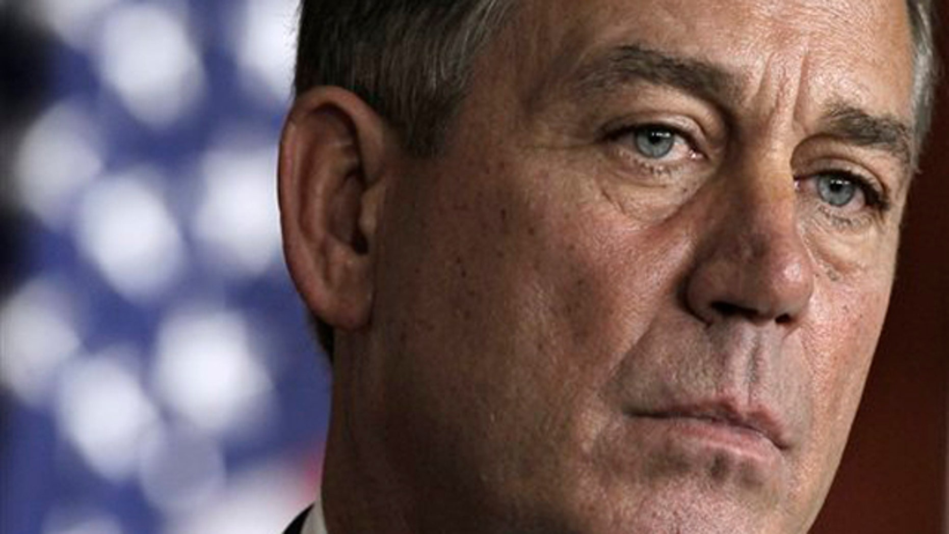 House Speaker John Boehner takes part in a news conference on Capitol Hill in Washington July 28.