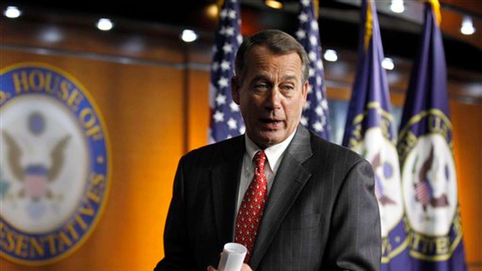 In this Dec. 17 photo, House Speaker-designate John Boehner talks with media on Capitol Hill in Washington.