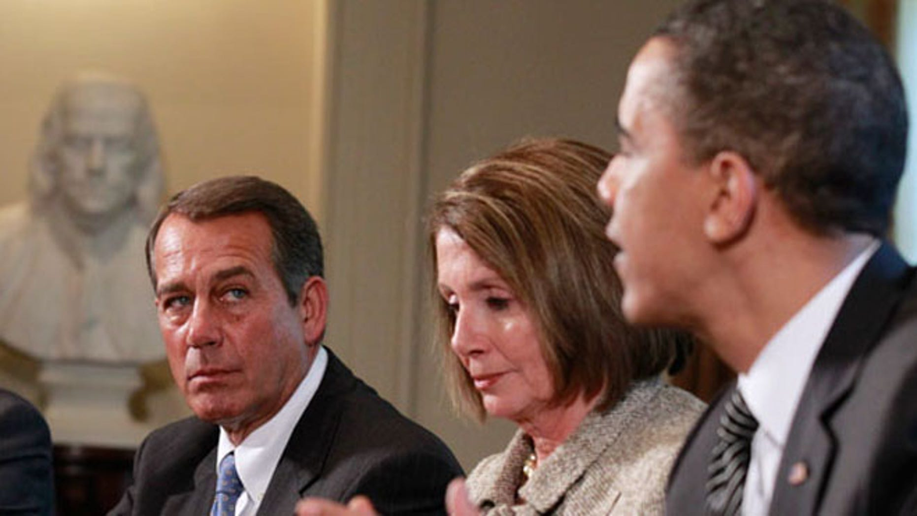 In this December 2010 file photo, President Obama is shown meeting with then-House Speaker Nancy Pelosi and then-House Republican Leader John Boehner.