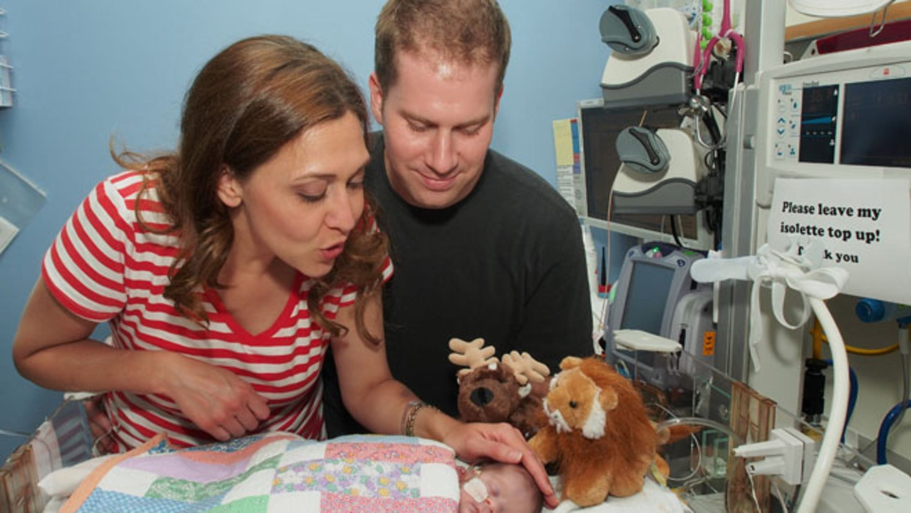 July 23, 2013: This file photo provided by the office of Rep. Jaime Herrera Beutler, R-Wash., shows Herrera Beutler, left, is with her husband, Dan Beutler, and their baby, Abigail Rose Beutler, at Lucile Packard Childrens Hospital in Palo Alto, Calif. (AP)