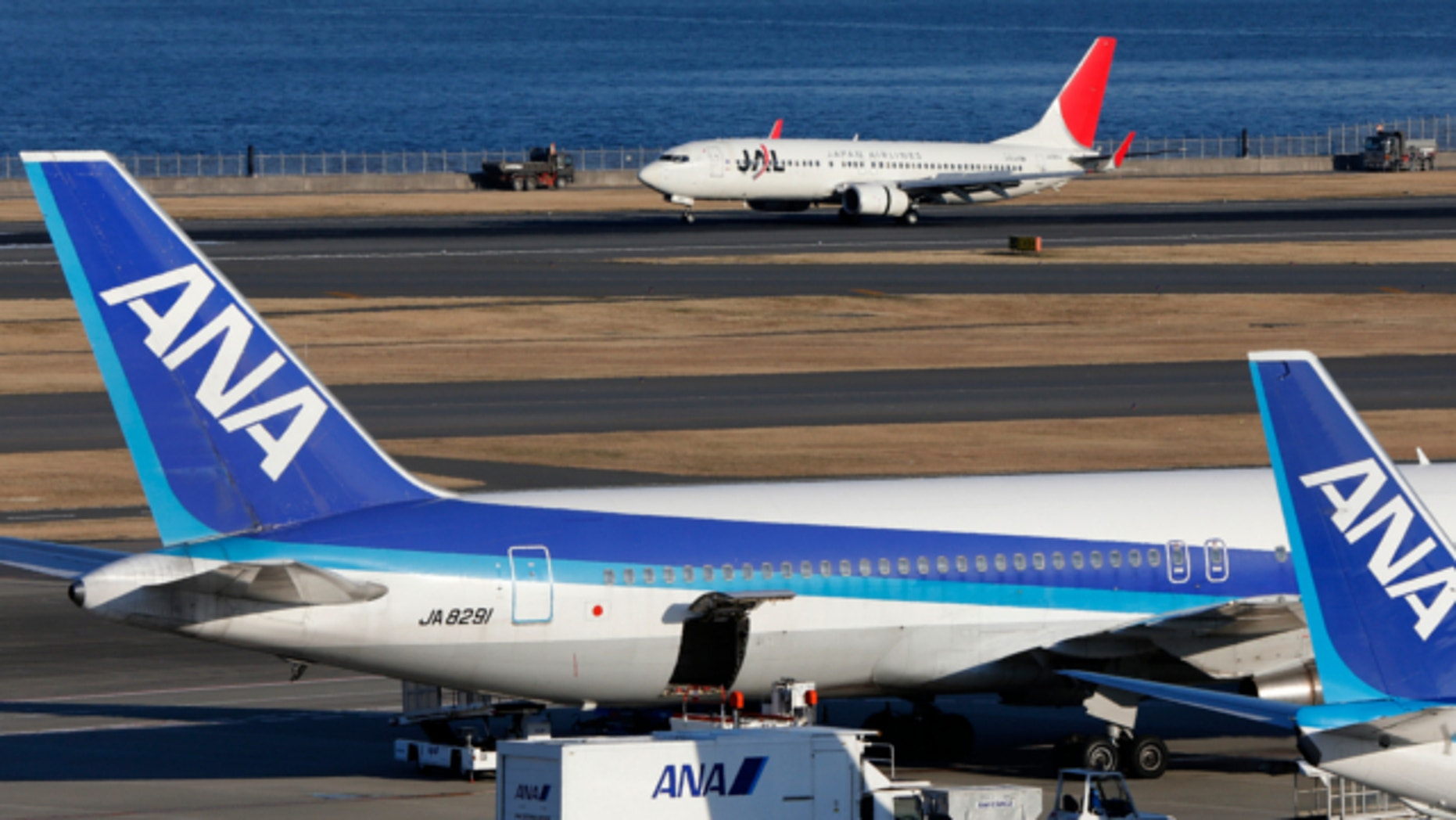 Jan. 30, 2013: All Nippon Airways passenger planes park on the tarmac of Haneda Airport in Tokyo.