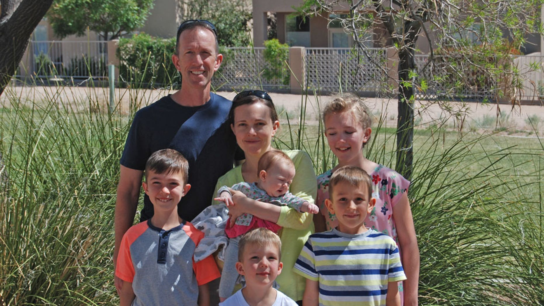Col. Leland Bohannon, seen here with his family, was suspended from command over his views, according to his attorney.
