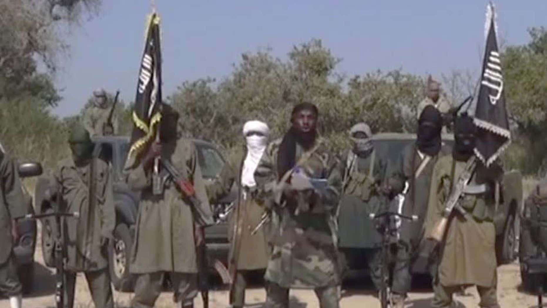OCt. 31, 2014: Photo of members of Nigeria's Islamic extremist group Boko Haram, Islamic extremists from Nigeria attacked a border town inside Niger, marking the 2nd foreign country attacked by the group in several days.