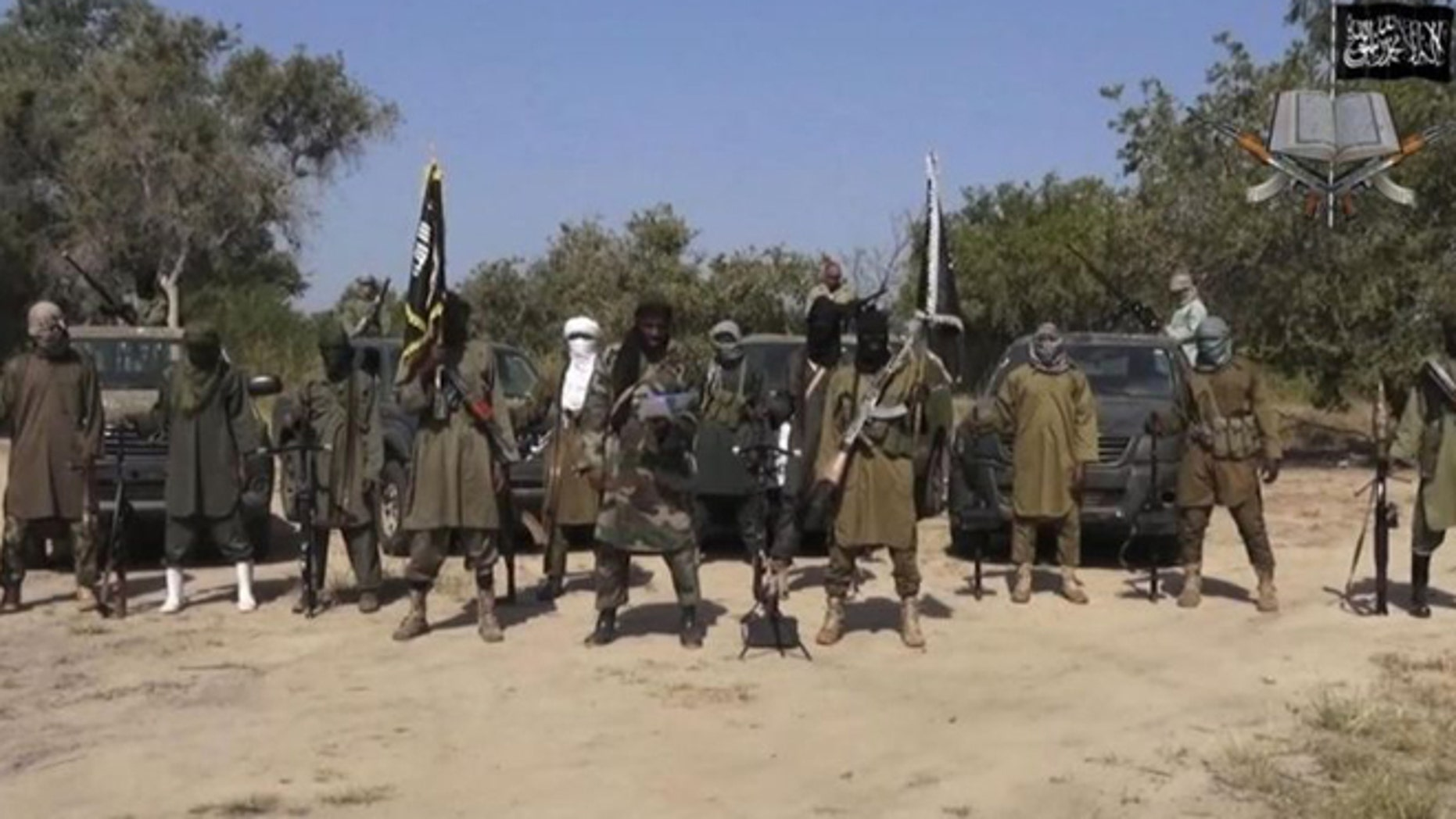 This file image taken from video released Oct. 31, 2014, by Boko Haram, shows Abubakar Shekau, center, the former leader of Nigeria's Islamic extremist group.