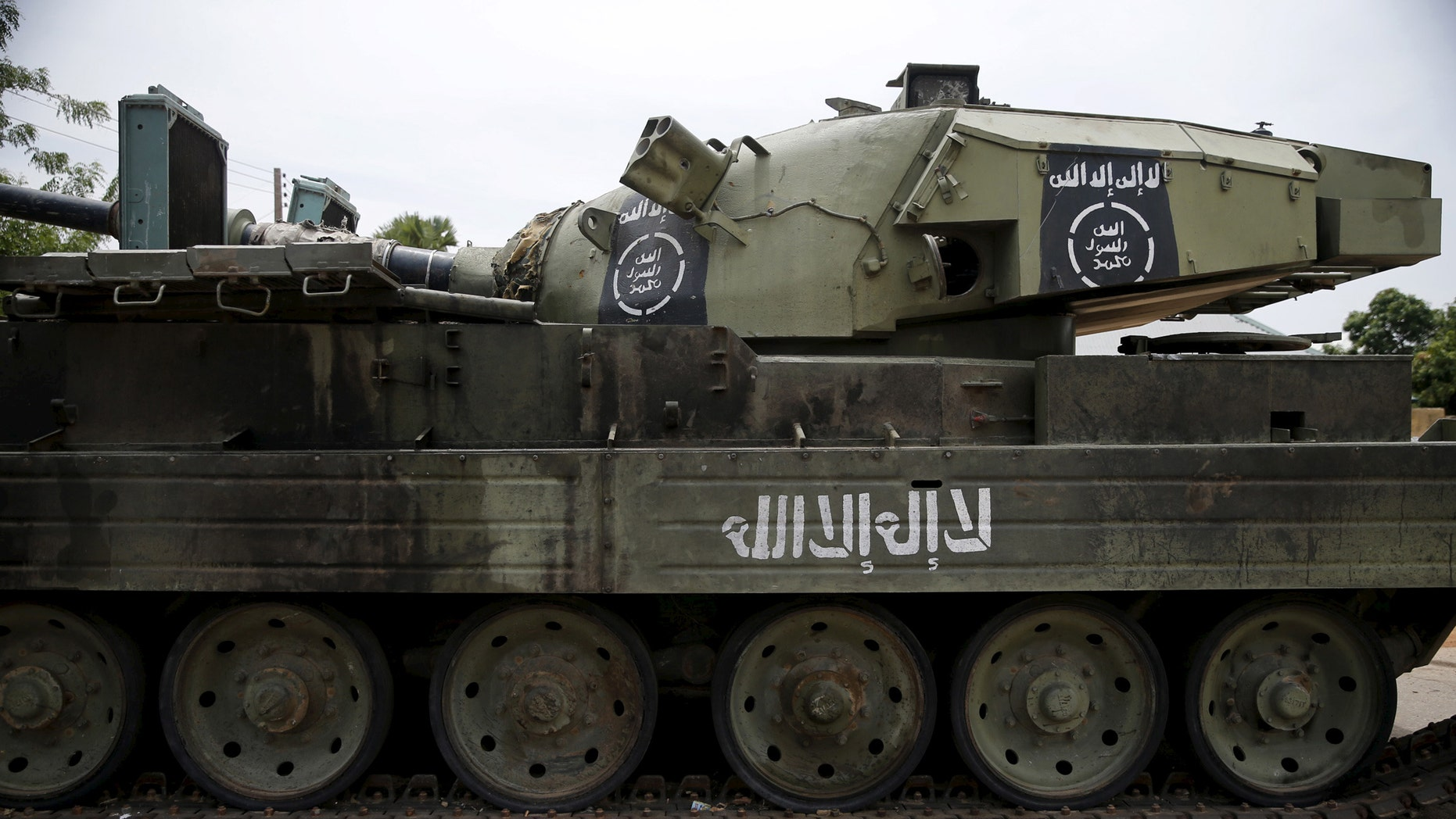 File photo - An armoured tank is seen abandoned along a road in Bazza town, after the Nigerian military recaptured it from Boko Haram, in Adamawa state May 10, 2015. (REUTERS/Akintunde Akinleye)