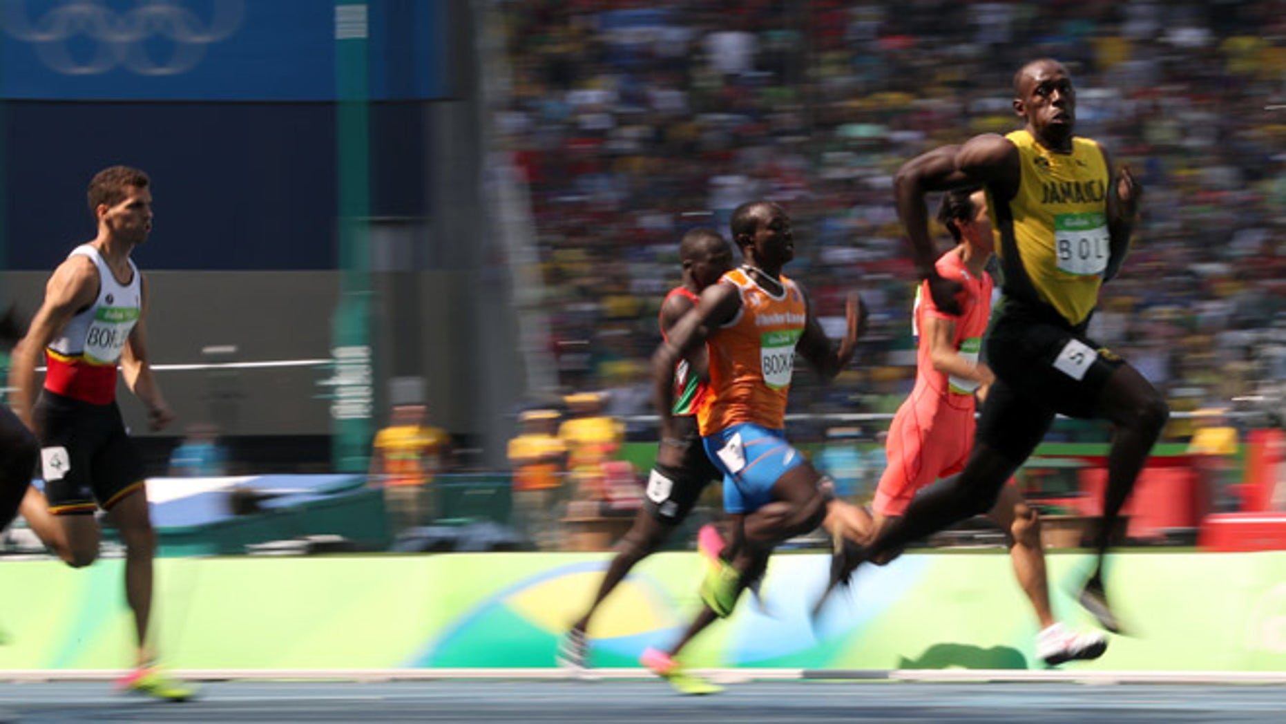 Jamaica's Usain Bolt, right, competes in a men's 200-meter heat during the athletics competitions of the 2016 Summer Olympics at the Olympic stadium in Rio de Janeiro, Brazil, Tuesday, Aug. 16, 2016.