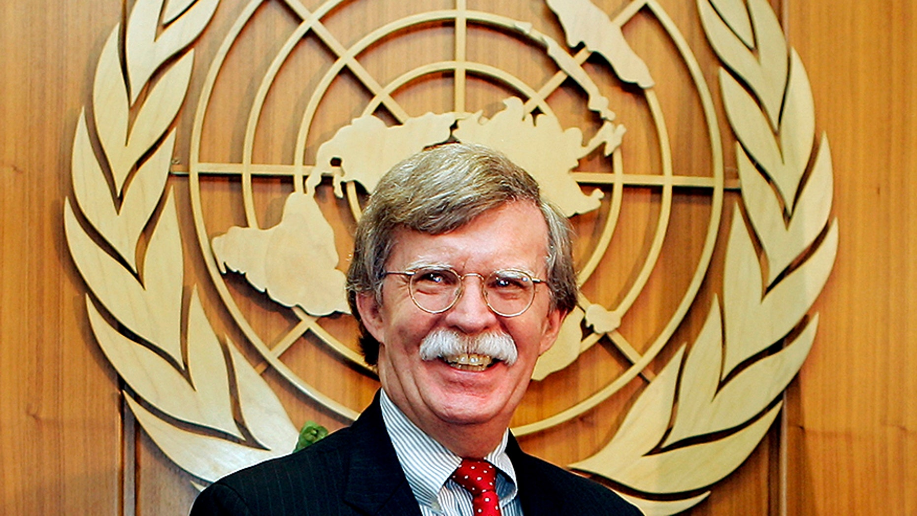 John Bolton, new United States Ambassador to the United Nations, smiles during a meeting to present his credentials to United Nations Secretary-General Kofi Annan at the U.N. headquarters in New York August 2, 2005.