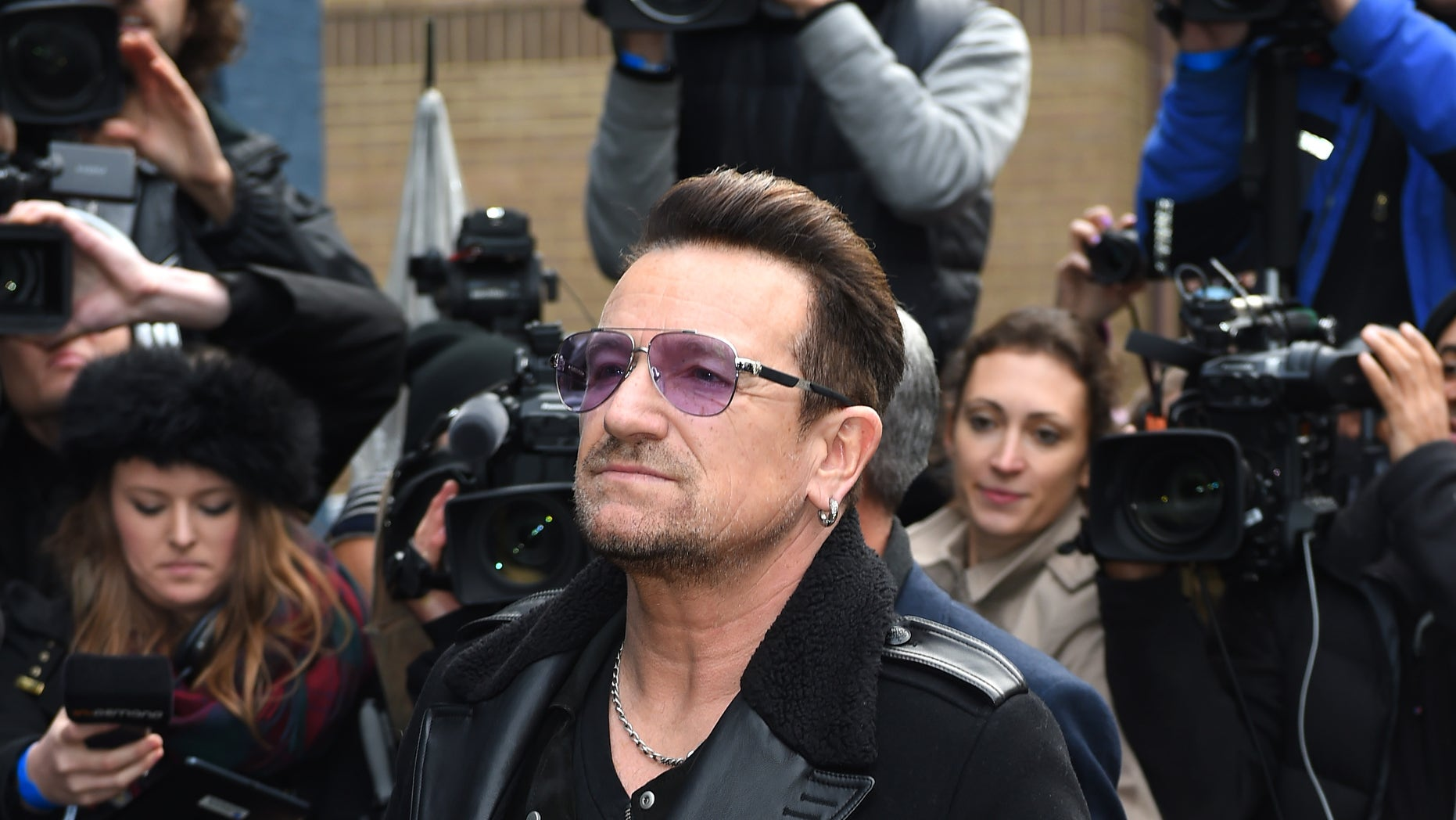 November 15, 2014. Singer Bono arrives at a music studio to record his segment of the new Band Aid 30 charity single in London.