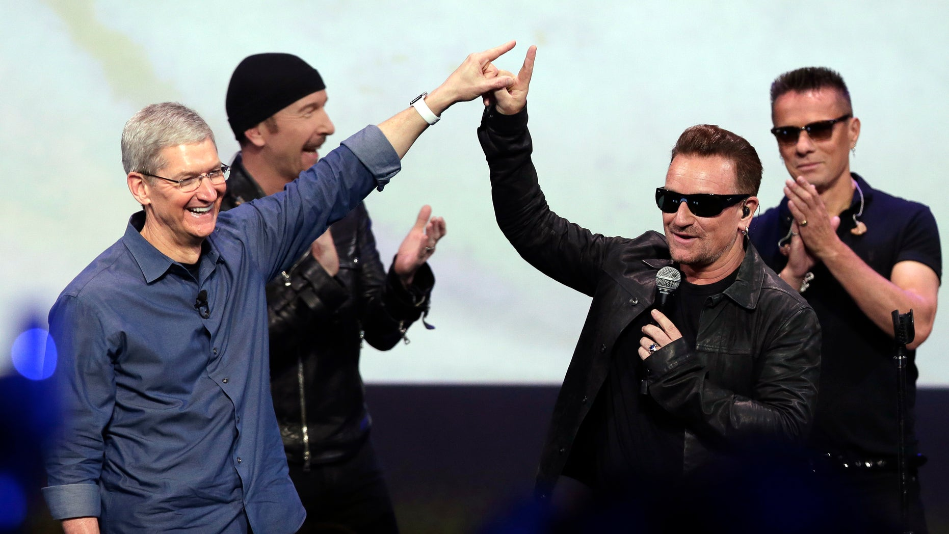 Sept. 9, 2014: Apple CEO Tim Cook, left, greets Bono from the band U2 after they preformed at the end of the Apple event in Cupertino, Calif.