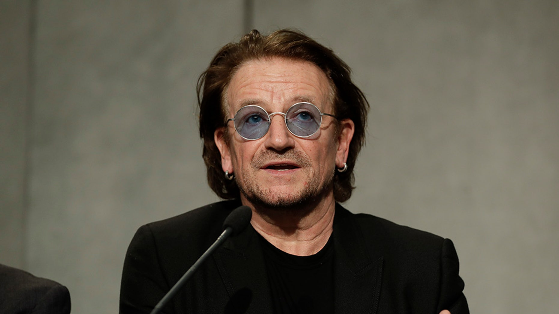 U2 rock band frontman Bono Vox talks to reporters during a press conference he held at the end of a meeting with Pope Francis, at the Vatican, Wednesday, Sept. 19, 2018. (AP Photo/Andrew Medichini)