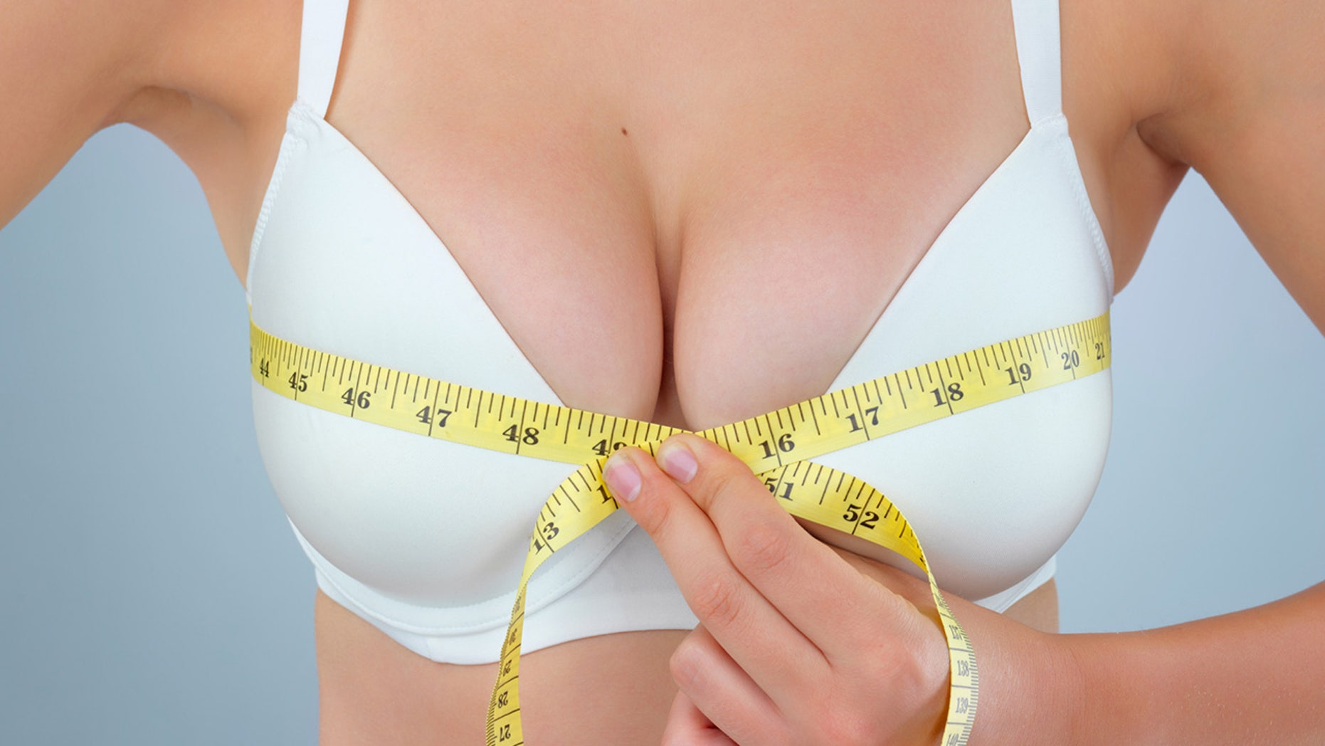 Playmate considers breast reduction surgery after nearly knocking herself out with one.