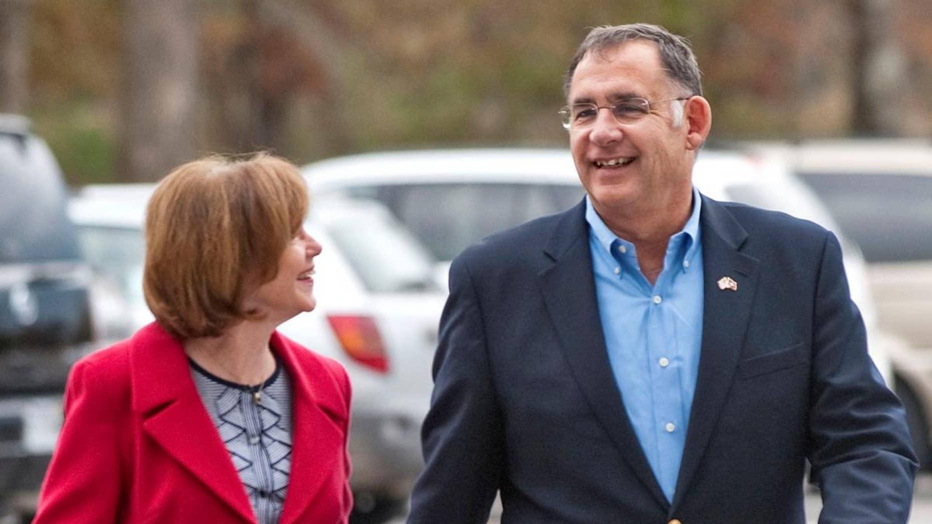 Sen. John Boozman walks with his wife, Cathy Boozman. (AP File Photo/Beth Hall)