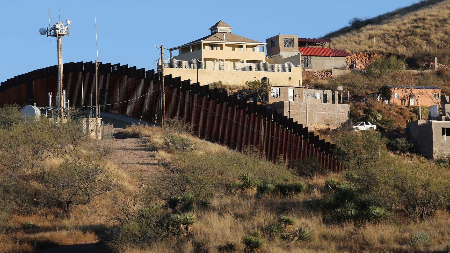 NOGALES, AZ - DECEMBER 09:  A suspected narco obvervation house stands on the Mexican side of the U.S.-Mexico border fence on December 9, 2014 near Nogales, Arizona. With increased manpower and funding in recent years, the Border Patol has seen the number illegal crossings and apprehensions of undocumented immigrants decrease in the Tucson sector. Agents are waiting to see if the improved U.S. economy and housing construction will again draw more immigrants from the south.  (Photo by John Moore/Getty Images)