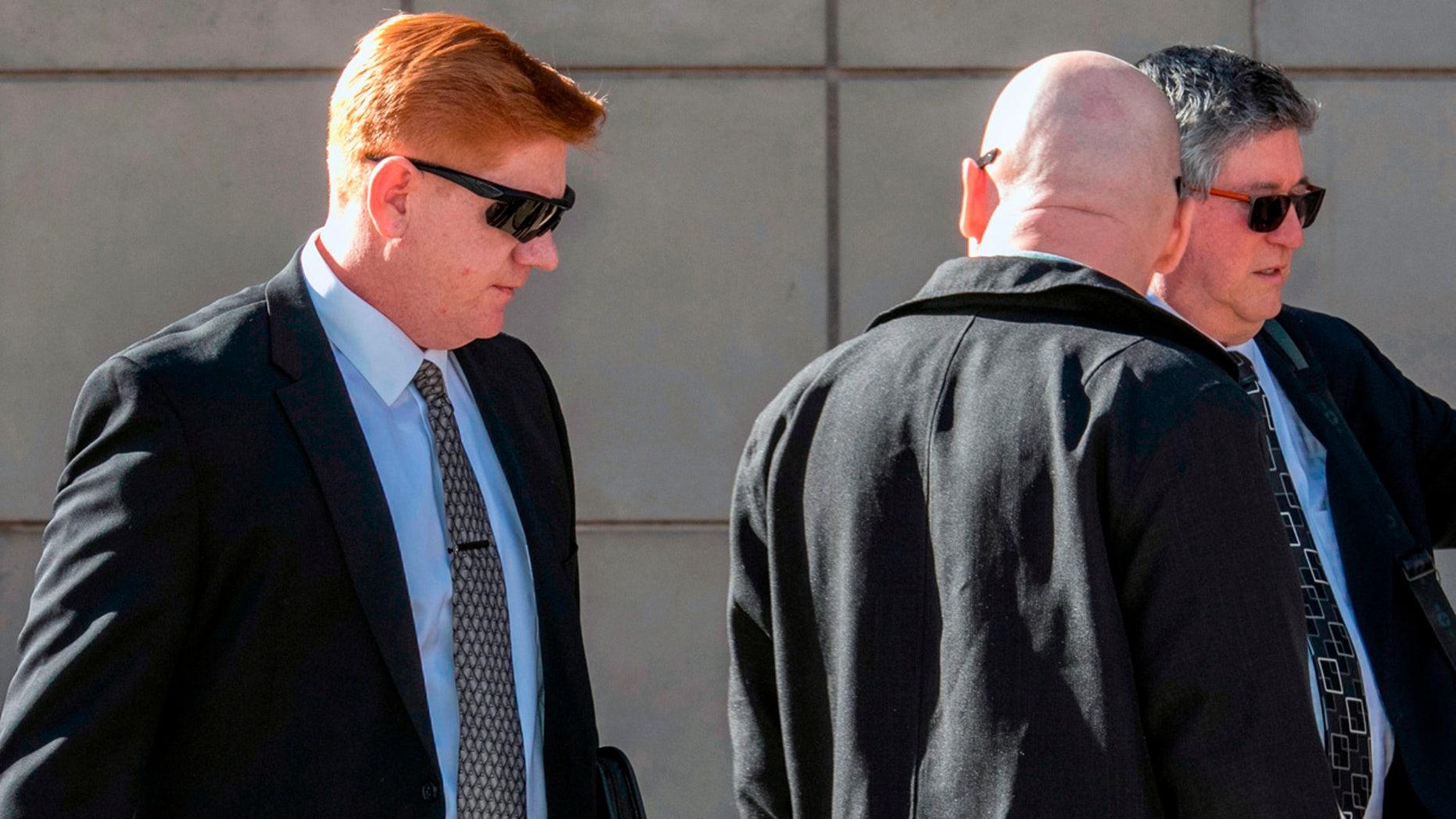 Lonnie Swartz, left, walks into federal court in Tucson, Ariz. last month.