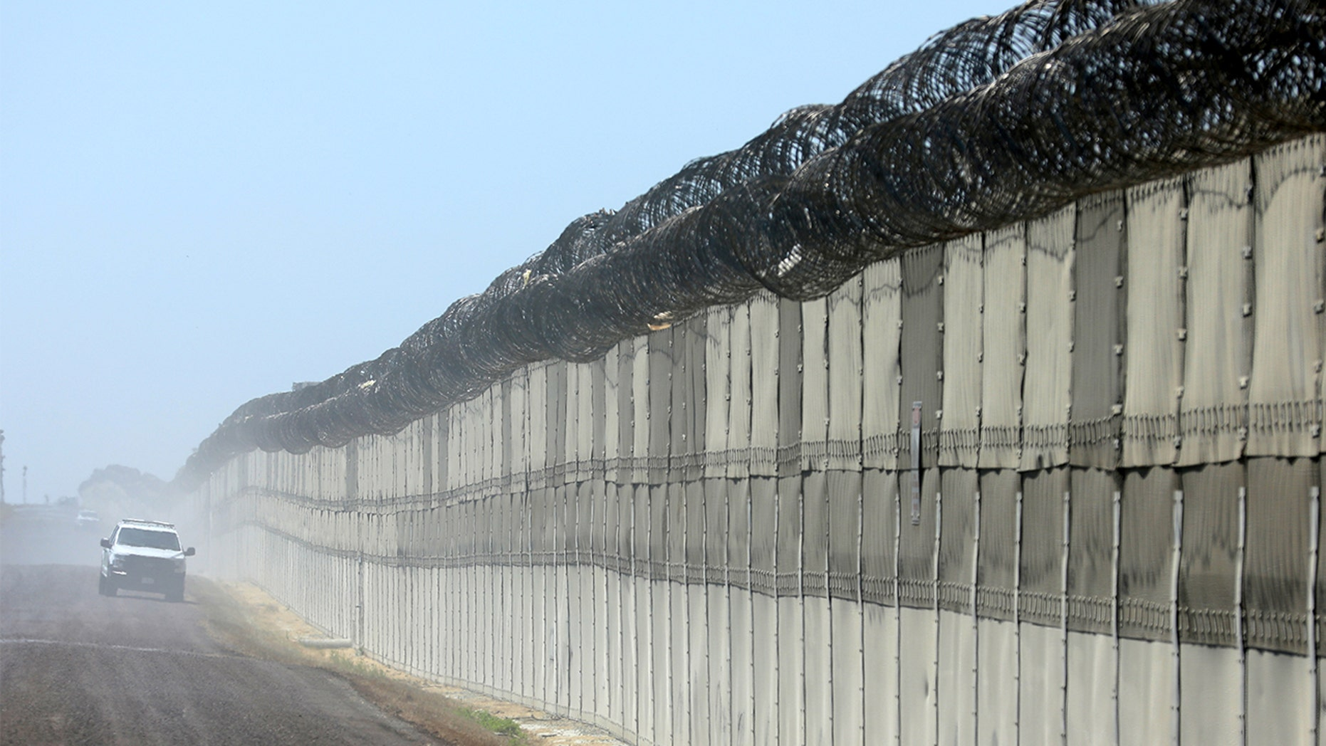 A U.S. border patrol agent fatally shot an illegal immigrant in Texas Wednesday, authorities said. File photo showing the fence along the U.S. southern border.