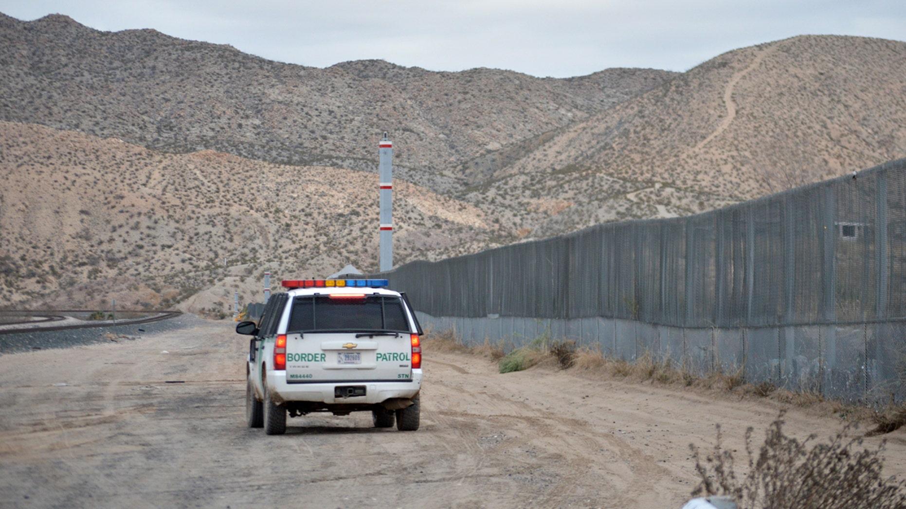 Jan. 4, 2016: , A U.S. Border Patrol agent drives near the U.S.-Mexico border fence in Sunland Park, N.M.