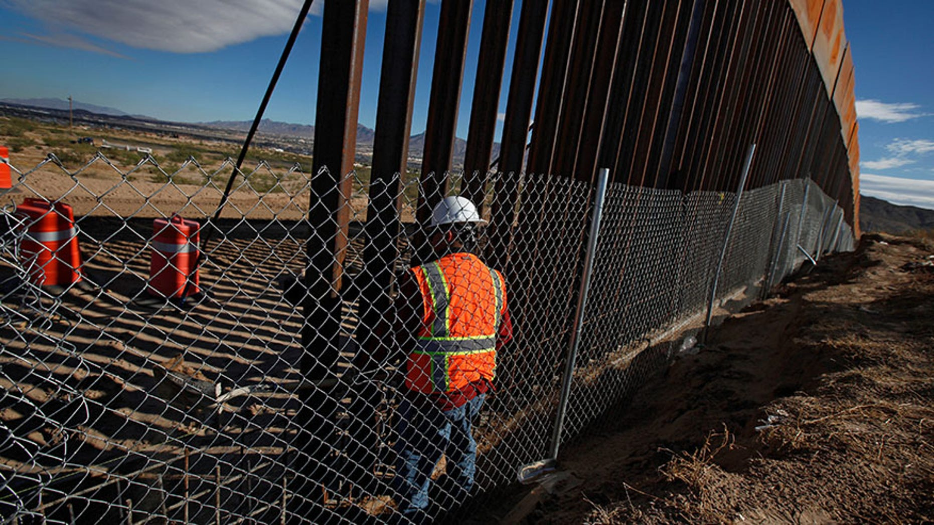 U.S. worker builds a section of the U.S.-Mexico border wall at Sunland Park, opposite Ciudad Juarez, on Nov. 9, 2016.