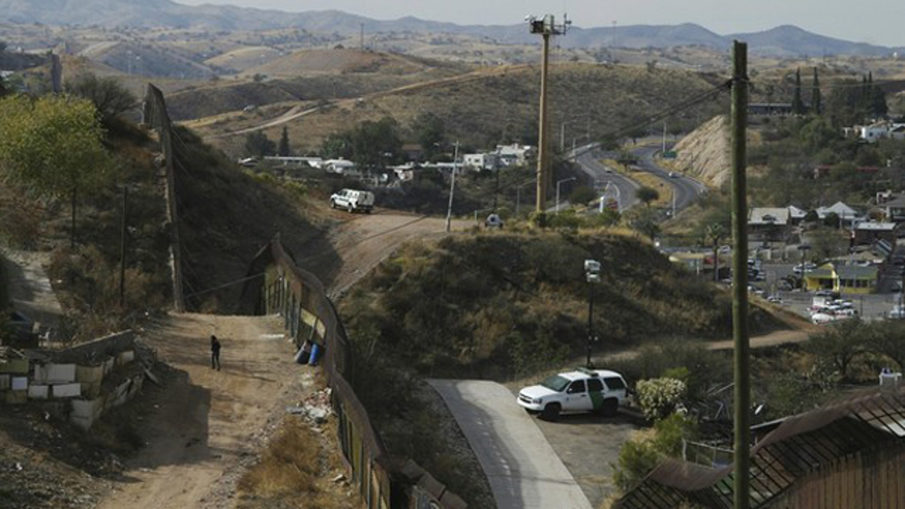 U.S. Border Patrol vehicles are seen from Nogales, Mexico, as they are parked near the border fence between the U.S. and Mexico Jan. 6.