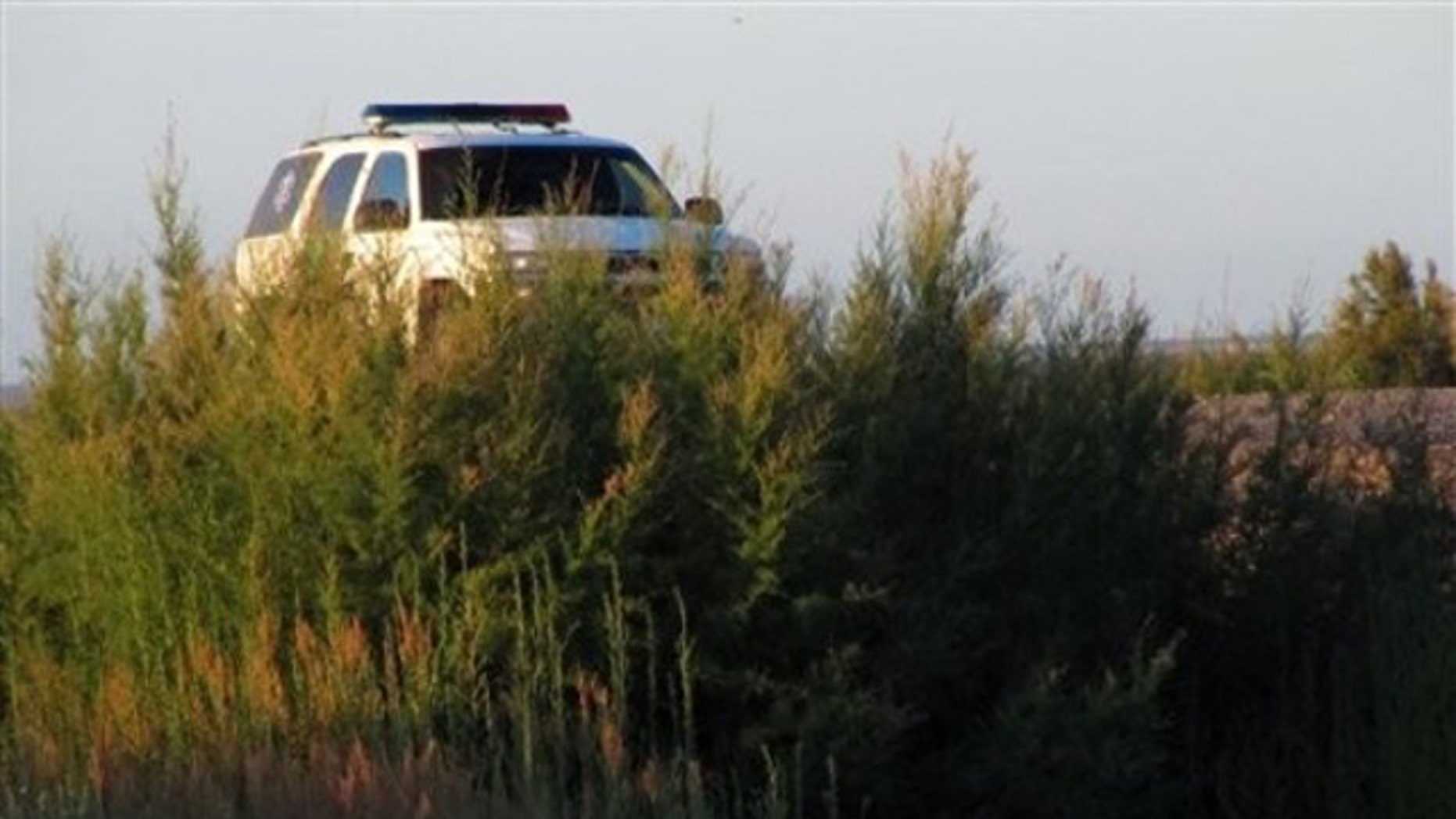 FILE: A U.S. Border Patrol truck is seen parked above a footbridge connecting Mexico with Texas. It would not be abandoned in the event of a government shutdown.