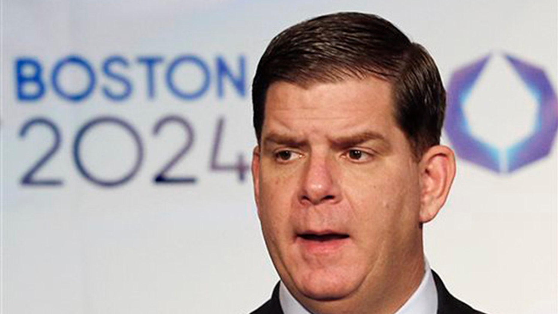 In this Jan. 9, 2015, file photo, Boston Mayor Martin Walsh speaks during a news conference in Boston after the city was picked by the USOC as its bid city for the 2024 Olympic Summer Games. (AP Photo/Winslow Townson, File)