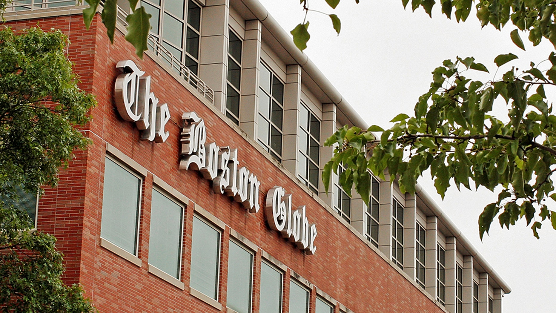 A man was arrested after threatening employees at the Boston Globe several times after the newspaper published an editorial against President Trump's attacks on the media, officials said.