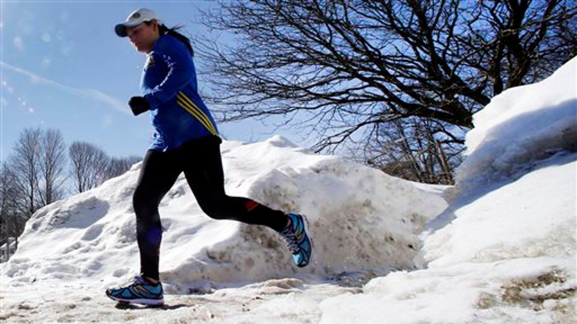 Runner Becca Pizzi, 34, trains along Heartbreak Hill in Newton, Mass., Friday, Feb. 27, 2015. (AP Photo/Elise Amendola)