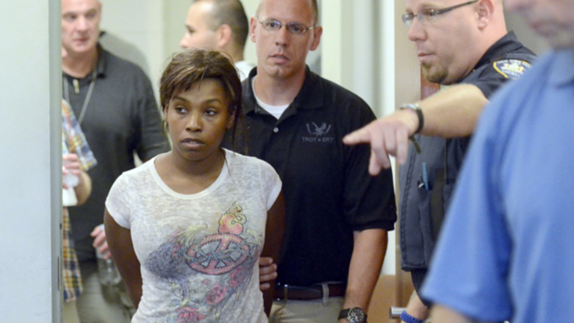 July 19, 2013: Audrea Gause, 26, of Troy, N.Y., is led into court in Troy, N.Y. to be arraigned on a Massachusetts fugitive warrant for defrauding the One Fund Boston of $480,000.