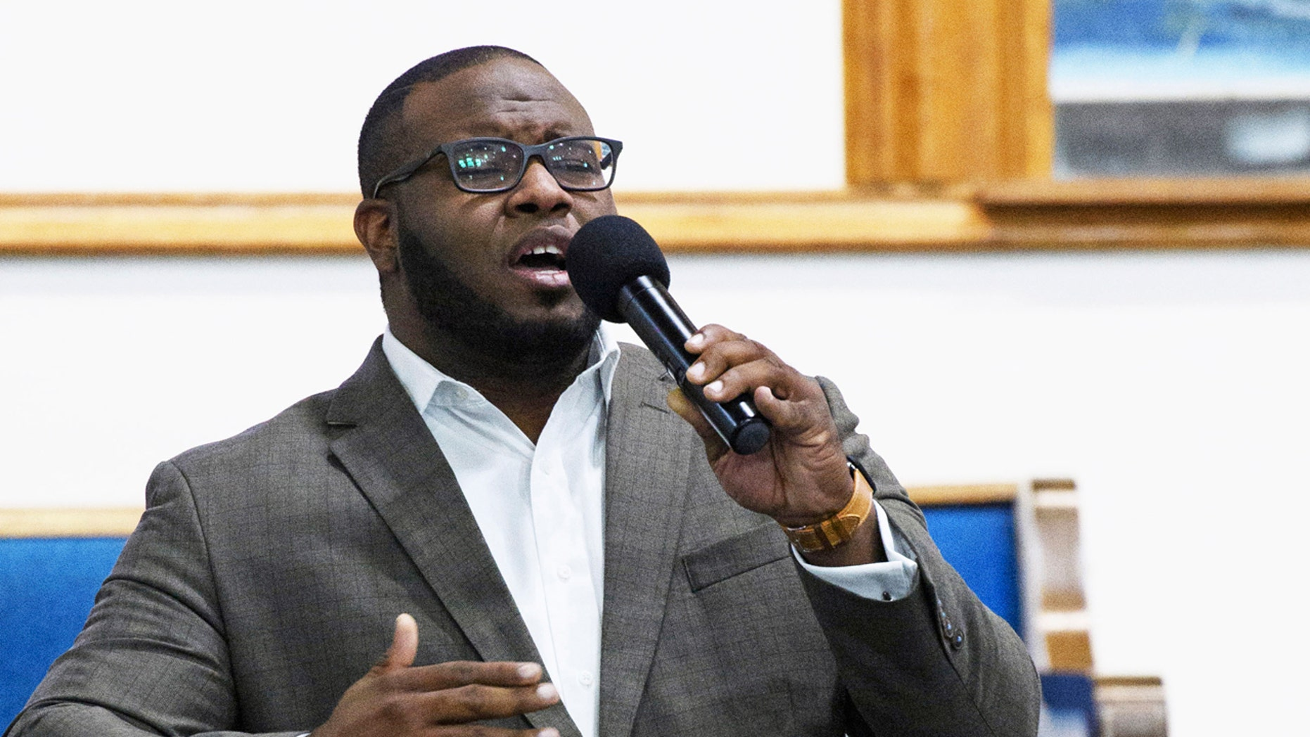 This Sept. 21, 2017, photo provided by Harding University in Search, Ark., shows Botham Jean leading worship at a university presidential reception in Dallas.