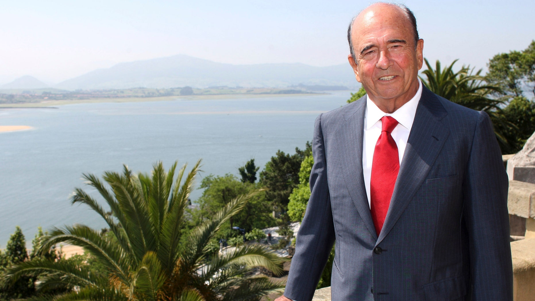 FILE - In this June 19, 2008 file photo, banker Emilio Botin poses at his home in Santander, Spain. Spanish banking magnate Botin, who built the country's Banco Santander into a global financial giant, has died Tuesday night, Sept. 9, 2014 of a heart attack. He was 79. Botin was known for his hands on leadership of the bank and turned the small institution run by his father into the eurozone's largest by market capitalization through a series of acquisitions. (AP Photo/Juan Manuel Serrano, File)