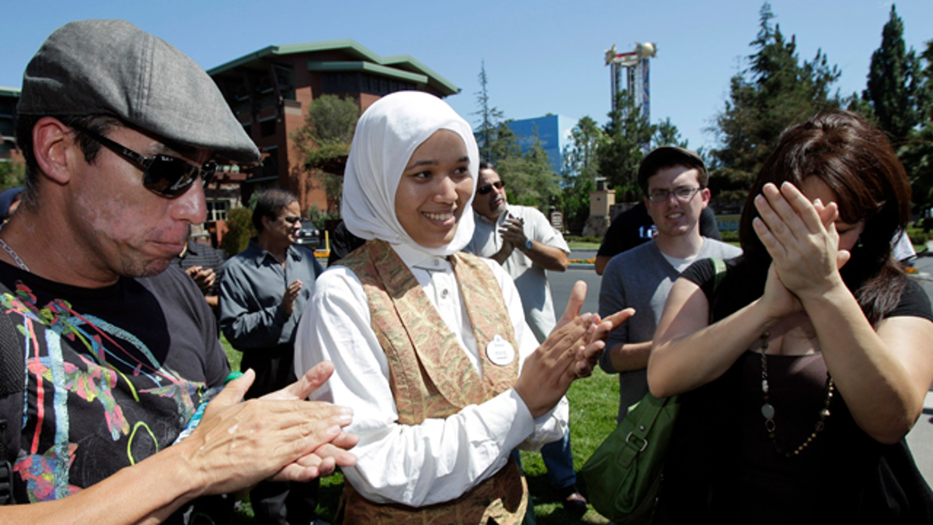 Aug. 18: Imane Boudlal, center, a Muslim woman who works as a hostess at a Disneyland restaurant, is joined by supporters during a news conference in Anaheim, Calif.