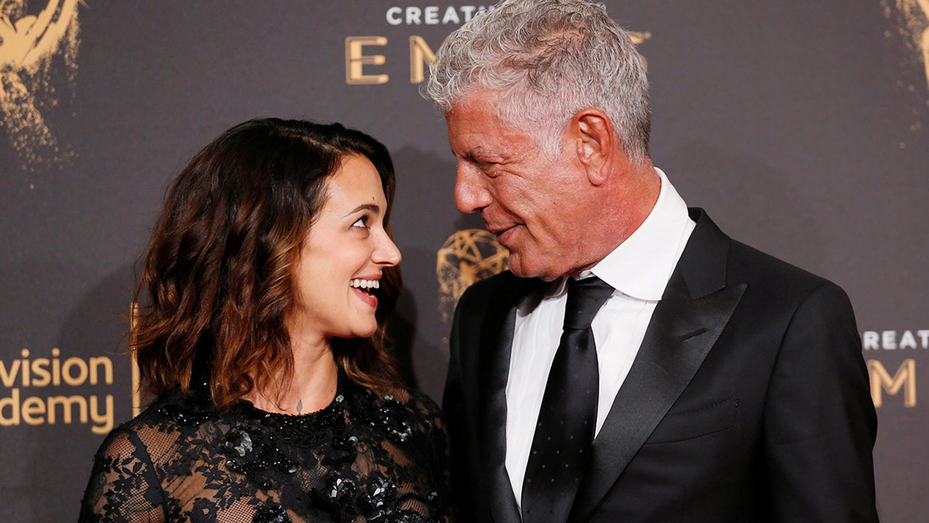 Anthony Bourdain (right) has defended his girlfriend, Asia Argento, over her claims that Harvey Weinstein sexually assaulted her.