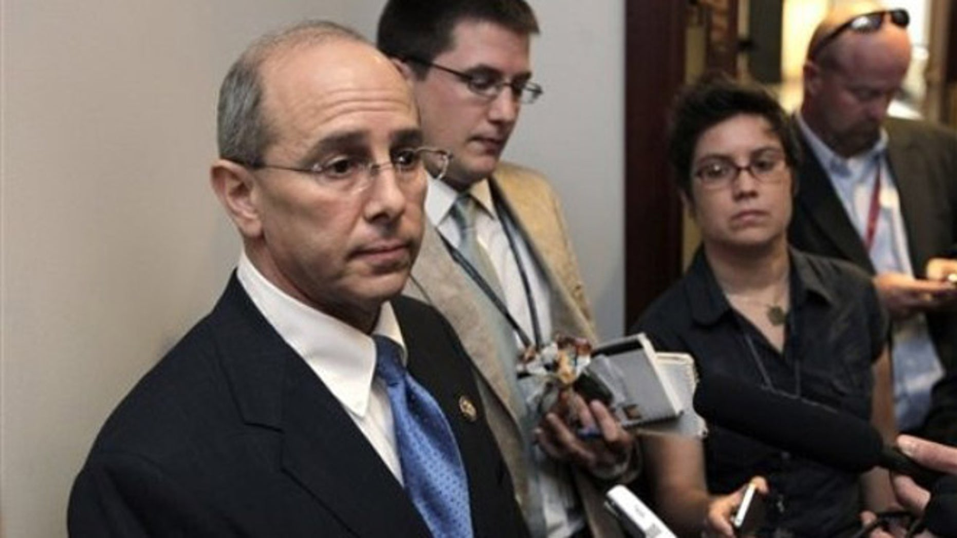 FILE: Rep. Charles Boustany, R-La., speaks with reporters after a closed-door meeting at the Capitol.