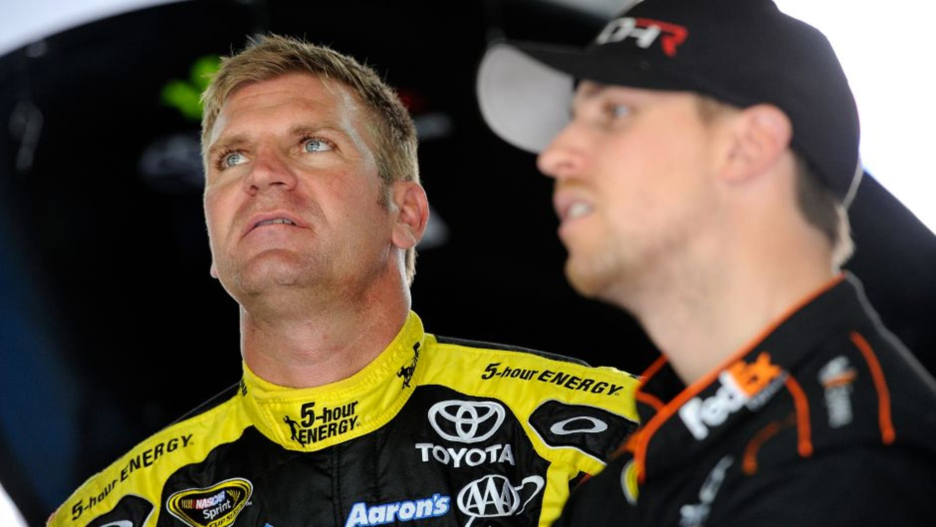 CHARLOTTE, NC - MARCH 11: Denny Hamlin(right), driver of the #11 FedEx Toyota, and Clint Bowyer, driver of the #15 5-Hour Energy Toyota, look over data in the garage area during the NASCAR Sprint Cup Series test at Charlotte Motor Speedway on March 11, 2015 in Charlotte, North Carolina. (Photo by Jared C. Tilton/NASCAR via Getty Images)