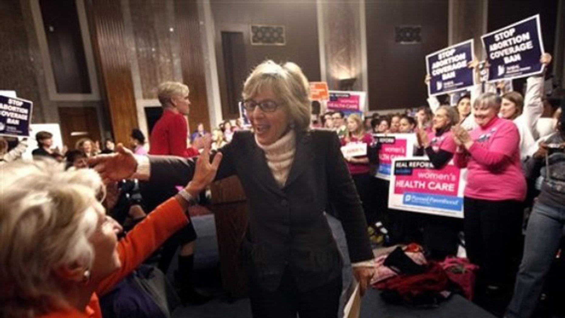 Sen. Barbara Boxer, D-Calif., greets participants at an abortion-rights rally Dec. 2 in Washington. (AP Photo)
