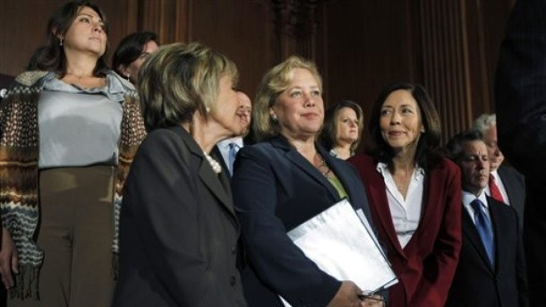 Sen. Mary Landrieu, D-La., accompanied by Sen. Barbara Boxer, D-Calif., and Sen. Maria Cantwell, D-Wash., at a news conference in Washington, Sept. 14, 2010.