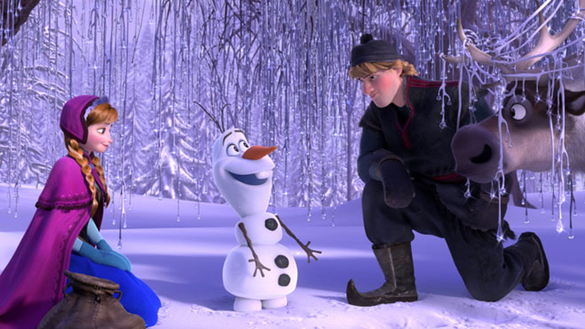 """This image released by Disney shows, from left, Anna, voiced by Kristen Bell, Olaf, voiced by Josh Gad, and Kristoff, voiced by Jonathan Groff in a scene from the animated feature """"Frozen."""" (AP Photo/Disney"""