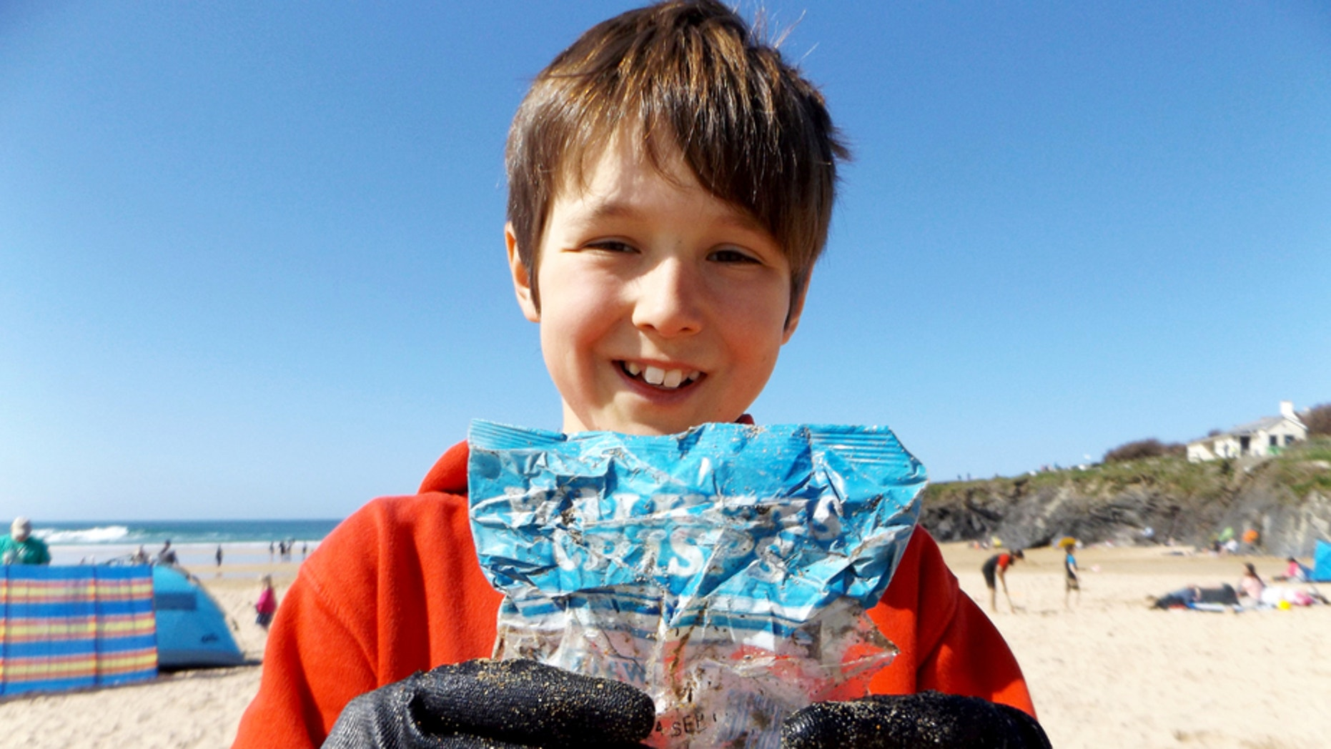 A 10-year-old boy who was cleaning up the beach was left shocked when he discovered a bag of chips from the 1980's.