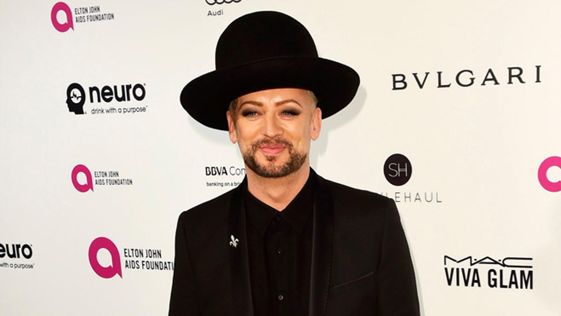 Boy George defended Melania Trump while at Paris Fashion Week.
