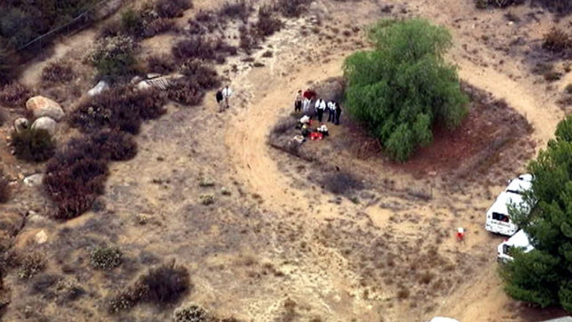 July 10, 2013: This video frame grab released courtesy of NBCLA.com shows an aerial view of investigators digging behind a Menifee, Calif., property in the search for 11-year-old Terry Smith.
