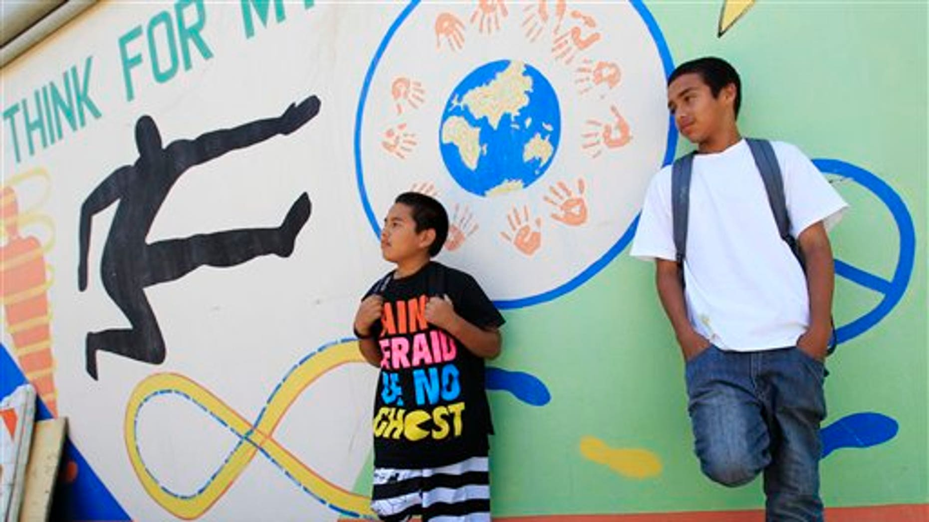 May 10: Van Buren Elementary school seventh grade students take a break at school in Stockton, California.