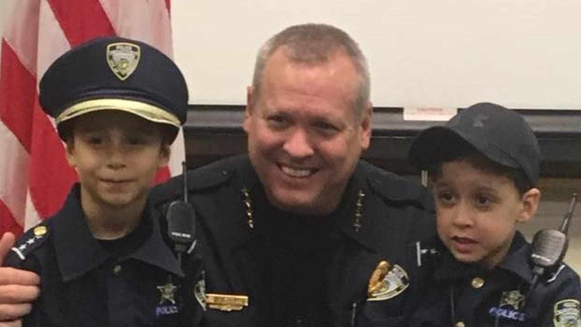 "Kissimmee Police Sgt. Sam Howard and Enzo Russell (left) pose for a picture after the 6-year-old was ""sworn in."""